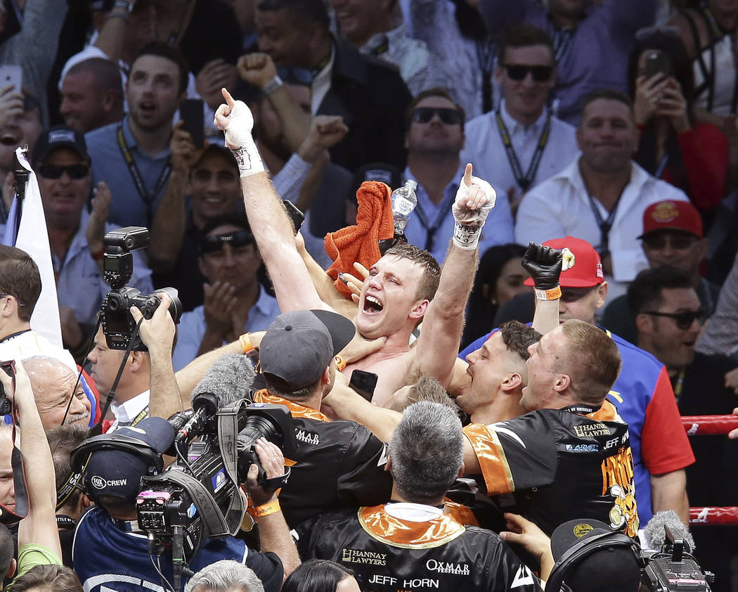 Jeff Horn of Australia celebrates after beating Manny Pacquiao of the Philippines during their WBO World Welterweight title fight in Brisbane, Australia, Sunday. July 2, 2017. (AP Photo/Tertius Pi ...