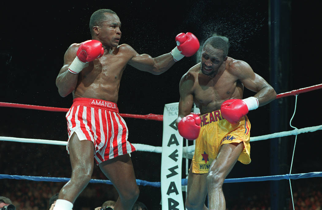 Sugar Ray Leonard, left, lands a blow to the head of Thomas Hearns in the 10th round of the their boxing fight in Las Vegas, Nv., Monday night, June 13, 1989.  The fight was ruled a decision by of ...