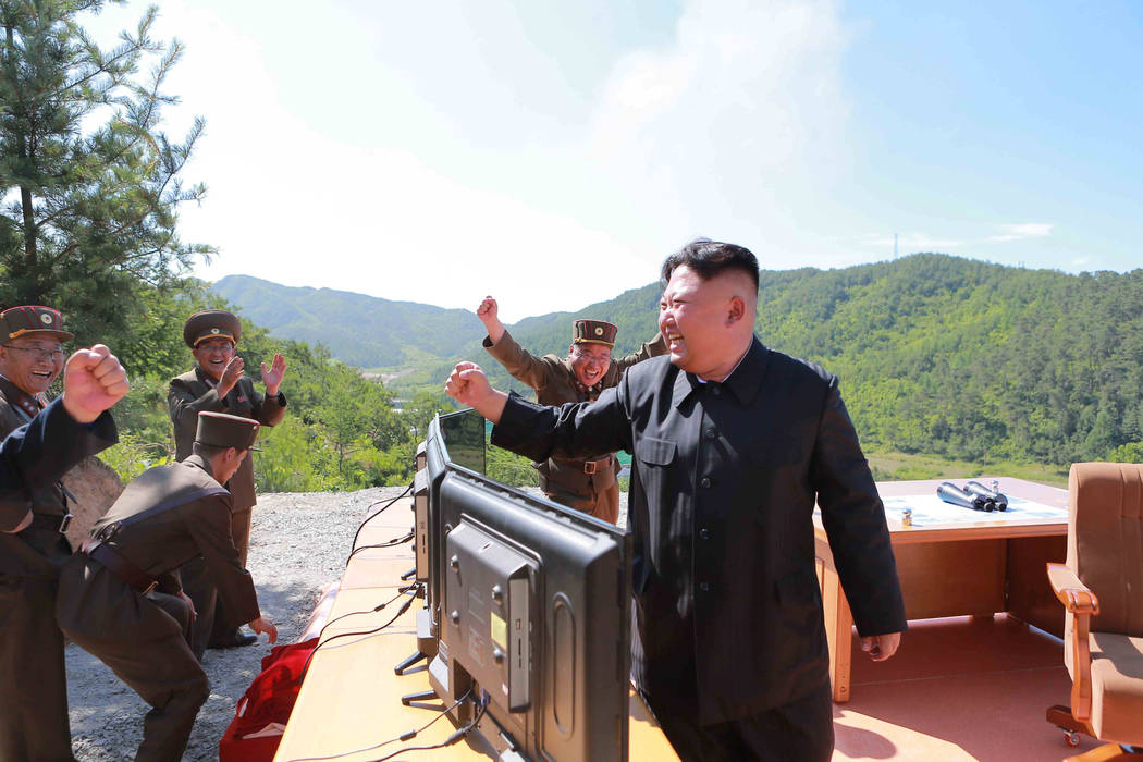 North Korean Leader Kim Jong Un reacts during the test-fire of intercontinental ballistic missile Hwasong-14 in this undated photo released by North Korea's Korean Central News Agency (KCNA) in Py ...