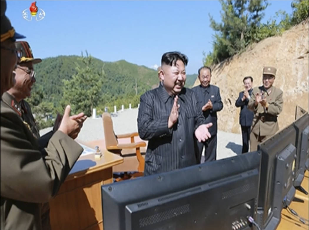 This image made from video of a news bulletin aired by North Korea's KRT on Tuesday, July 4, 2017, shows what was said to be North Korea leader Kim Jung Un, center, applauding after the launch of  ...