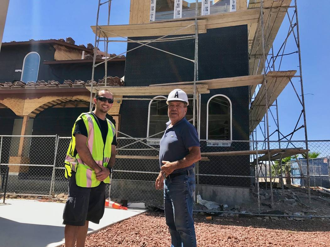 Tony Boghos, left and George Boghos, right, stand in front of the St. Michael's Antiochian construction site. Tony Boghos has recently joined his father in the construction business and has helped ...