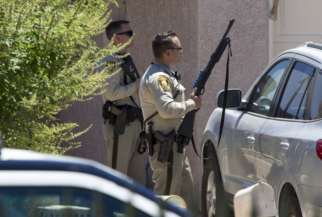 Las Vegas police work the scene of a shooting incident in the 8800 block of Brescia Drive on Tuesday, July 4, 2017. (Richard Brian/Las Vegas Review-Journal) @vegasphotograph