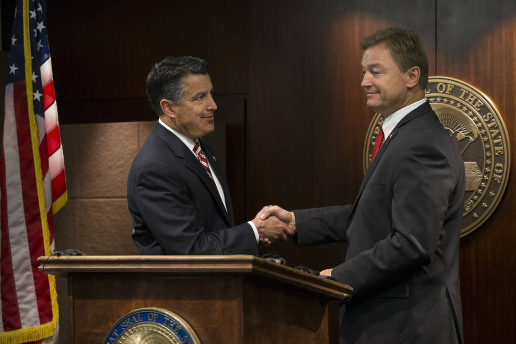 Nevada Gov. Brian Sandoval and Sen. Dean Heller after the senator announced he will vote no on the proposed healthcare bill at the Sawyer Building on Friday, June 23, 2017 in Las Vegas. Erik Verdu ...