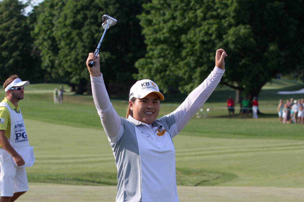 Jun 14, 2015; Harrison, NY, USA; Inbee Park celebrates her win during after the final round of the KPMG Women's PGA Championship at Westchester Country Club - West. Park has now won the event for  ...