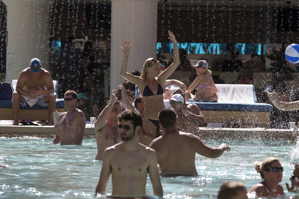 Guests mingle at the Garden of the Gods Pool Oasis at Caesars Palace in Las Vegas on Tuesday, July 4, 2017.  Richard Brian Las Vegas Review-Journal @vegasphotograph