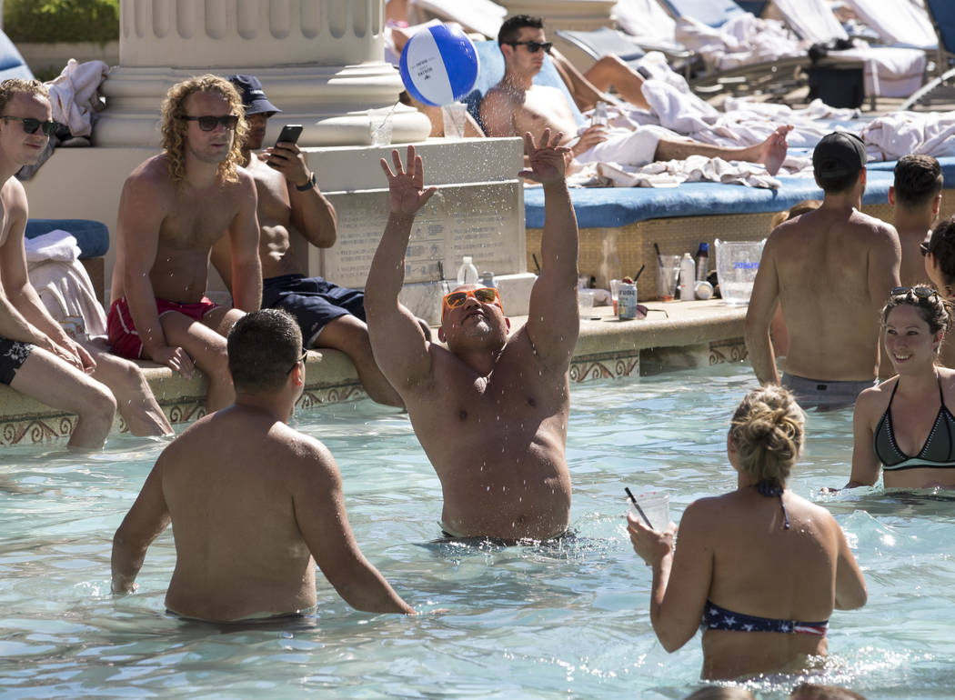 Guests mingle while playing beach ball at the Garden of the Gods Pool Oasis at Caesars Palace in Las Vegas on Tuesday, July 4, 2017.  Richard Brian Las Vegas Review-Journal @vegasphotograph