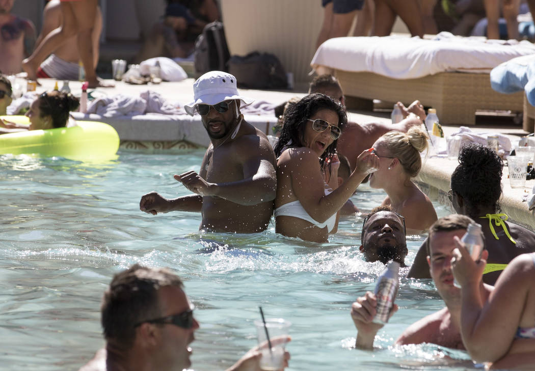 A couple gets their groove on at the Garden of the Gods Pool Oasis at Caesars Palace in Las Vegas on Tuesday, July 4, 2017.  Richard Brian Las Vegas Review-Journal @vegasphotograph