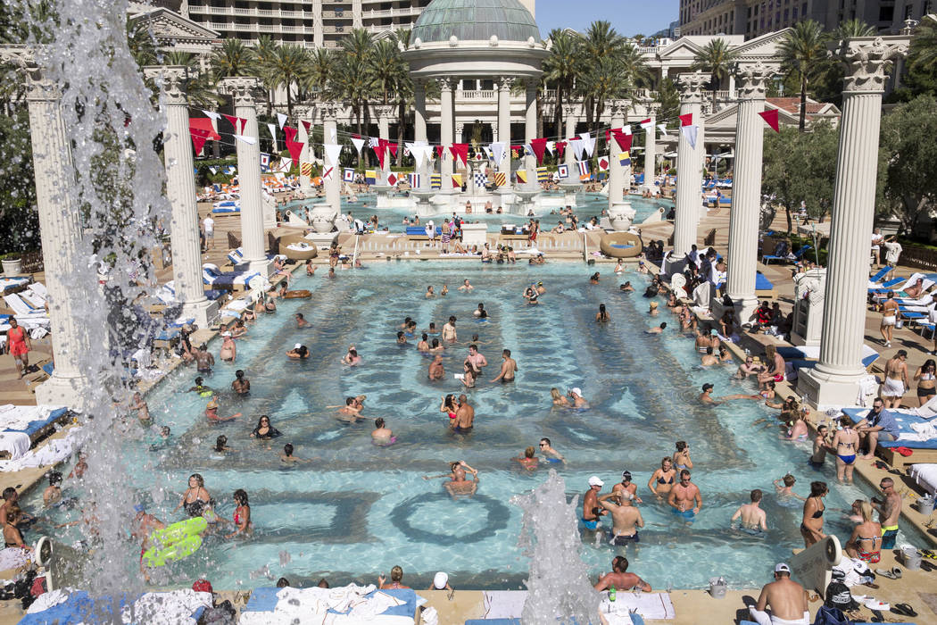 Sun and fun on the strip caesars style photos las for Caesars swimming pool