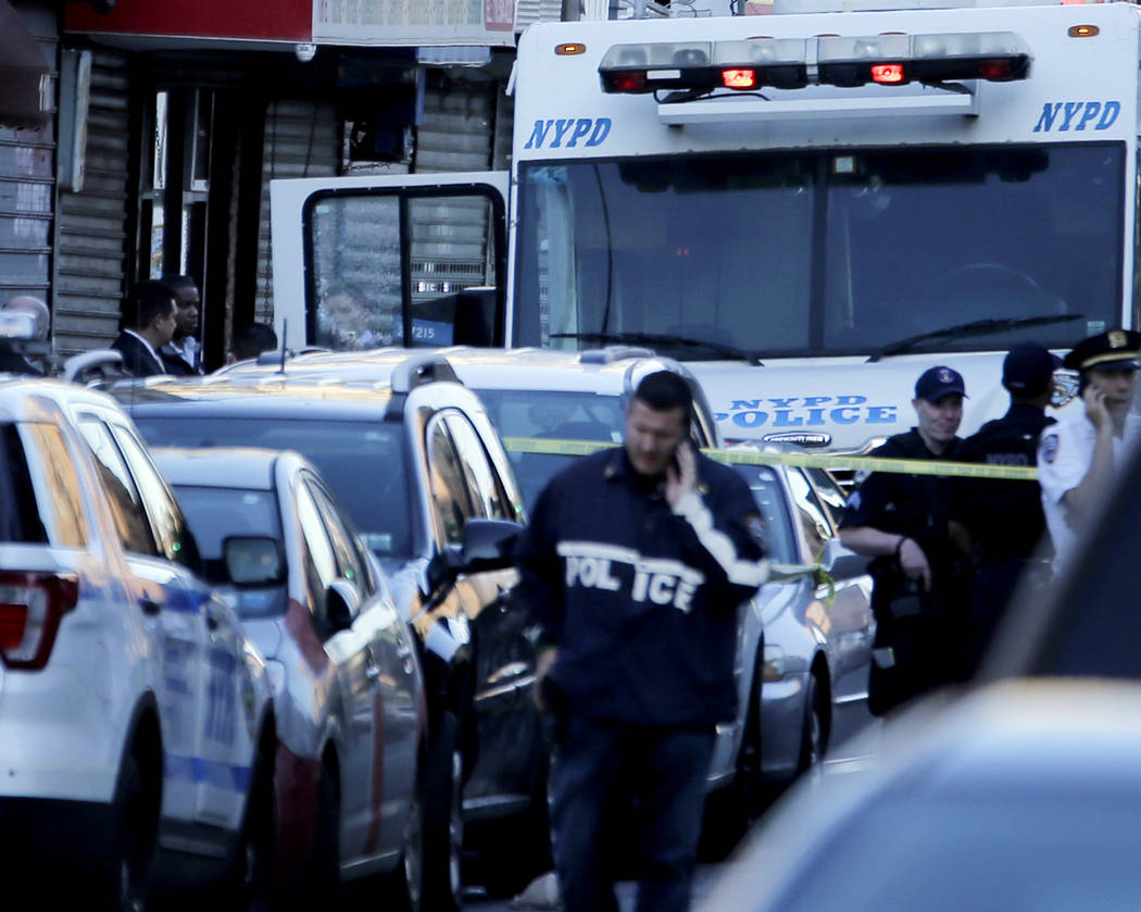 A NYPD vehicle with a cracked window sits on the scene where a police officer was fatally shot in the Bronx section of New York, Wednesday, July 5, 2017. (AP Photo/Seth Wenig)