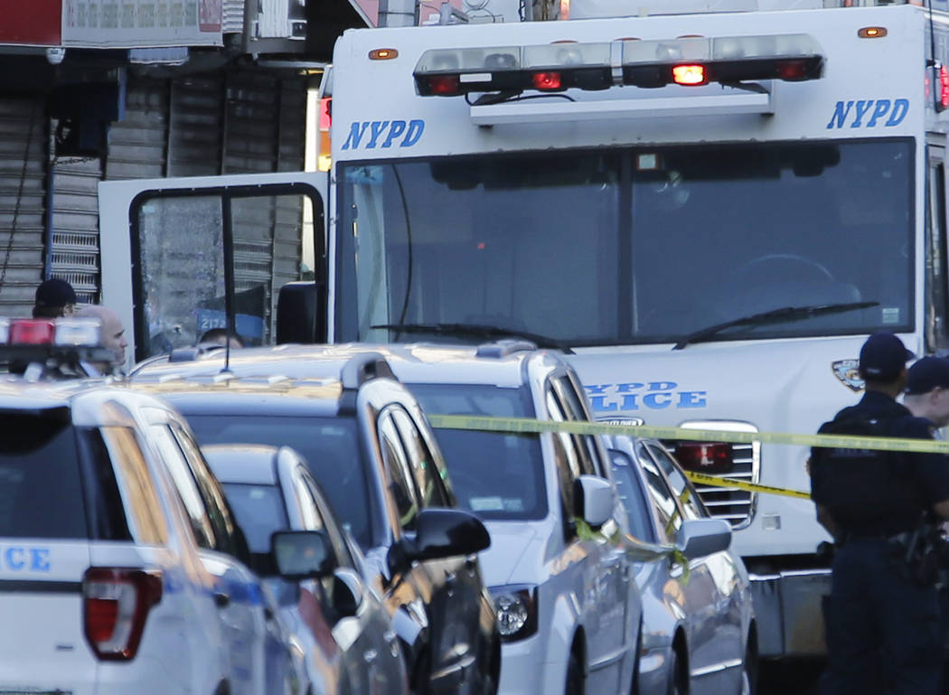 An NYPD vehicle with a cracked window sits on the scene where a police officer was fatally shot in the Bronx section of New York, Wednesday, July 5, 2017. Police said Officer Miosotis Familia died ...