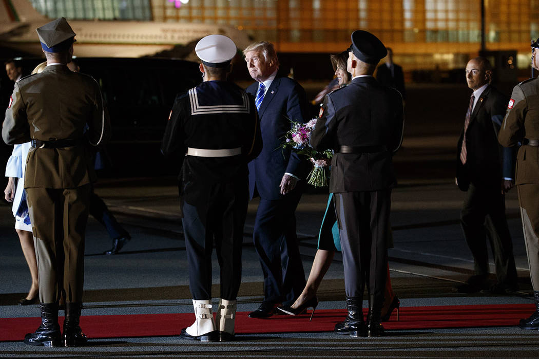 President Donald Trump and first lady Melania Trump walk to their vehicle after arriving at Warsaw Chopin Airport, Wednesday, July 5, 2017, in Warsaw. (AP Photo/Evan Vucci)