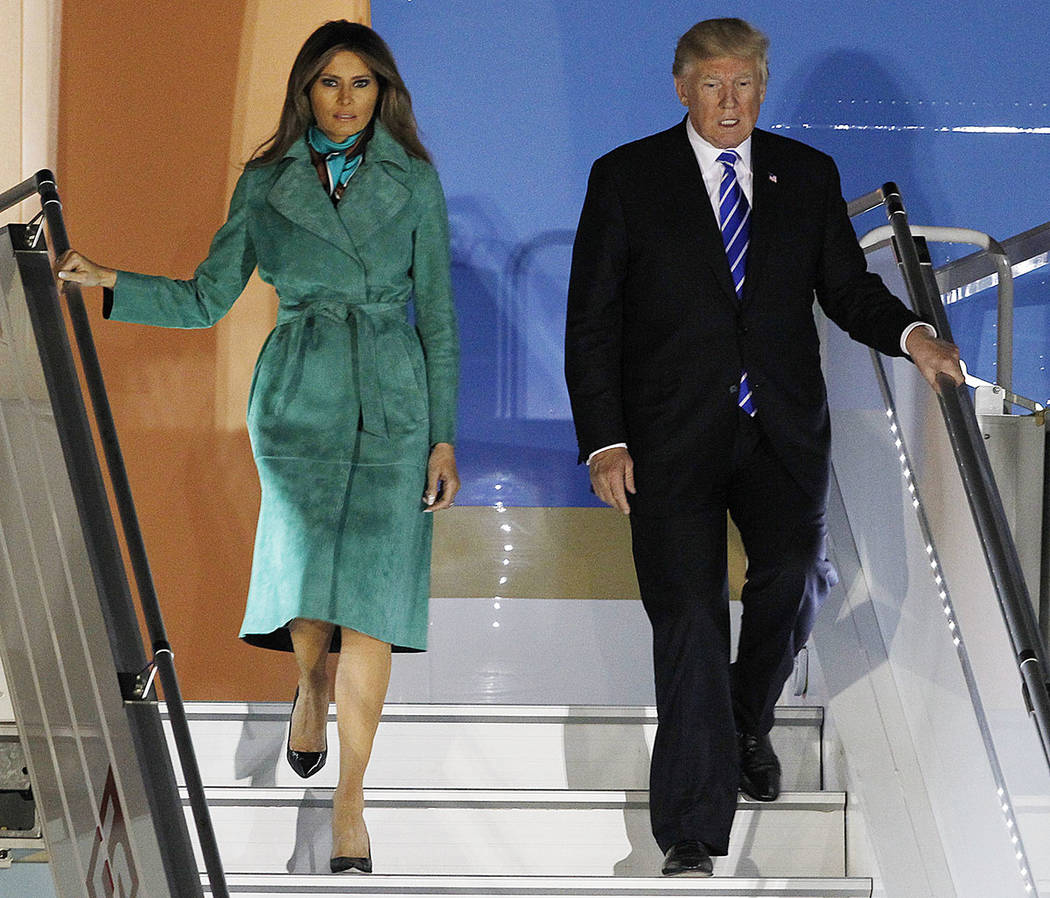President Donald Trump and the first lady Melania Trump exit Air force One upon their arrival in Warsaw, Poland, Wednesday, July 5, 2017. President Trump arrived in Poland ahead of an outdoor addr ...