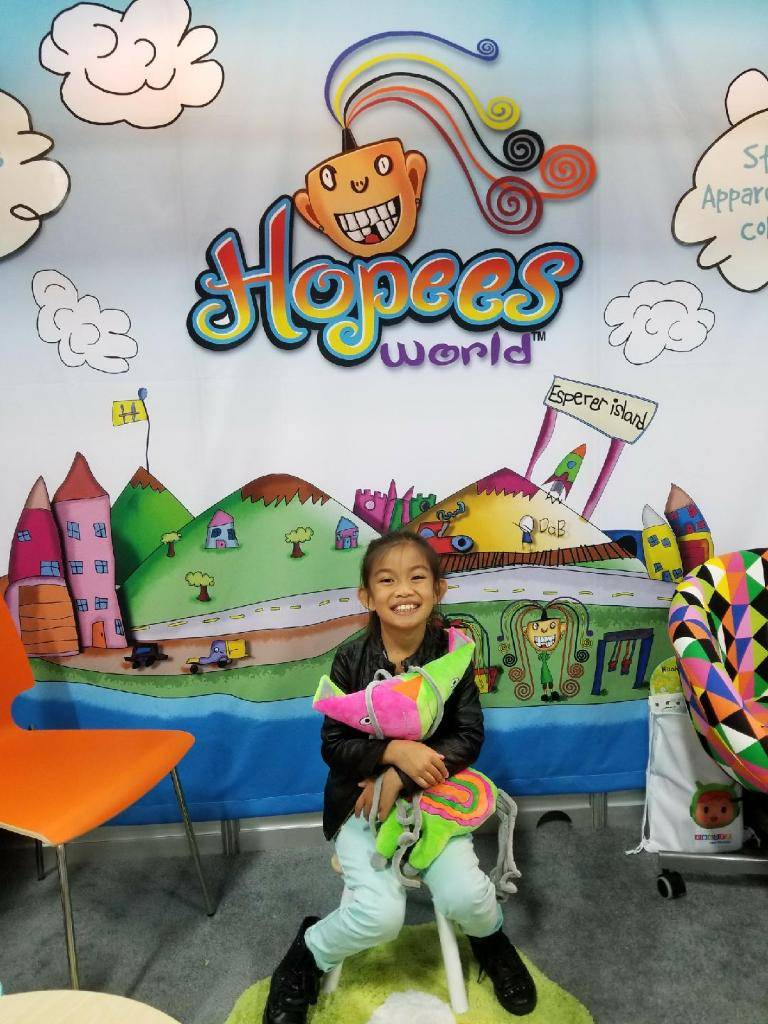 Hope Mathis, 7,  is seen at her booth at a toy convention in May 2017. Her parents have taken her ideas for an island filled with notable characters and made them into a fledgling toy line, workin ...
