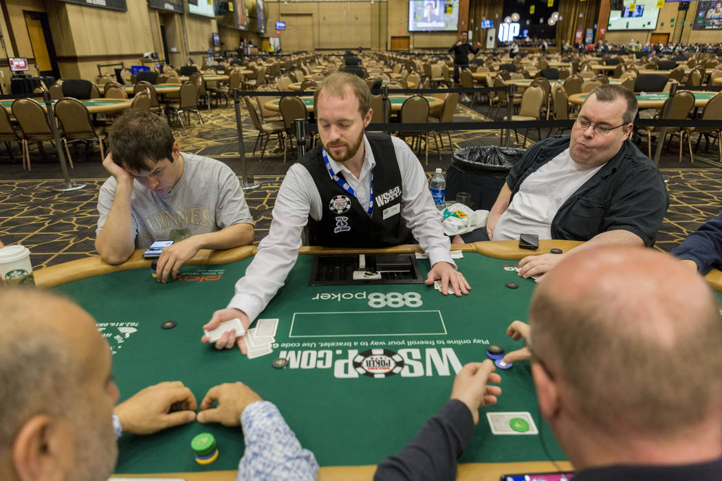 Poker dealer Tim Schmecht, center, deals a game during the 48th annual World Series of Poker at the Rio Convention Center in Las Vegas, Monday, July, 3, 2017. (Elizabeth Brumley/Las Vegas Review-J ...