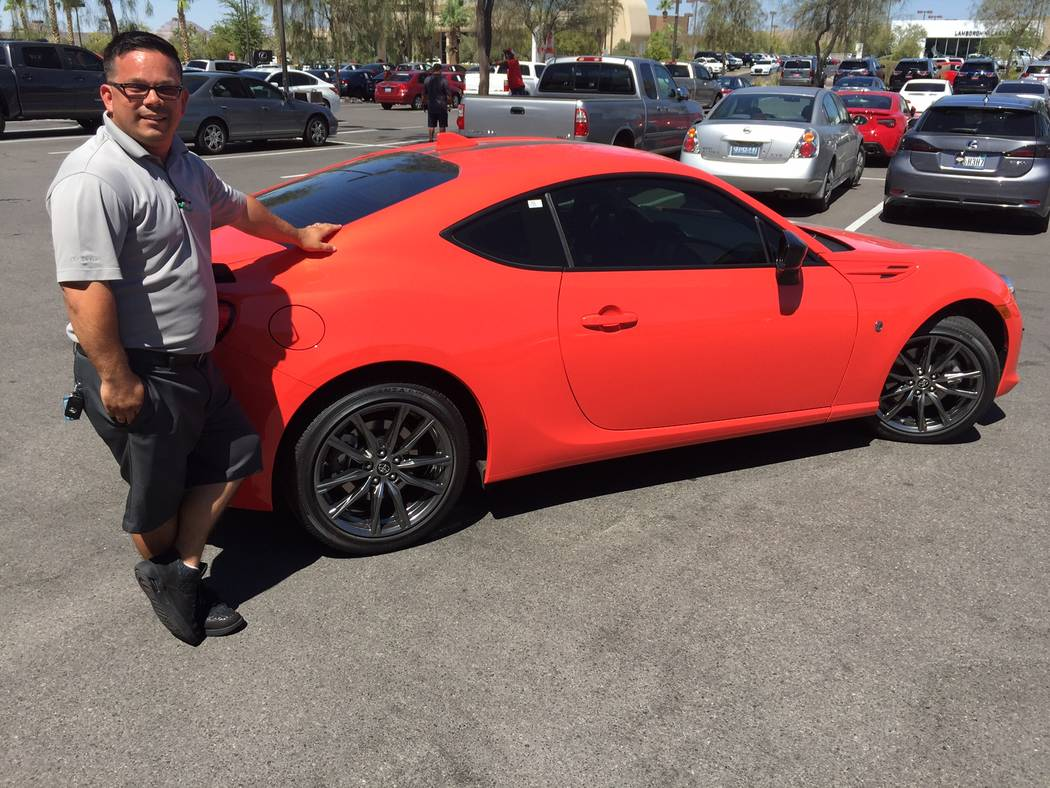 Findlay Toyota Findlay Toyota sales consultant Ken Kemp is seen with the popular 2017 Toyota 86 sports coupe in the Valley Automall.