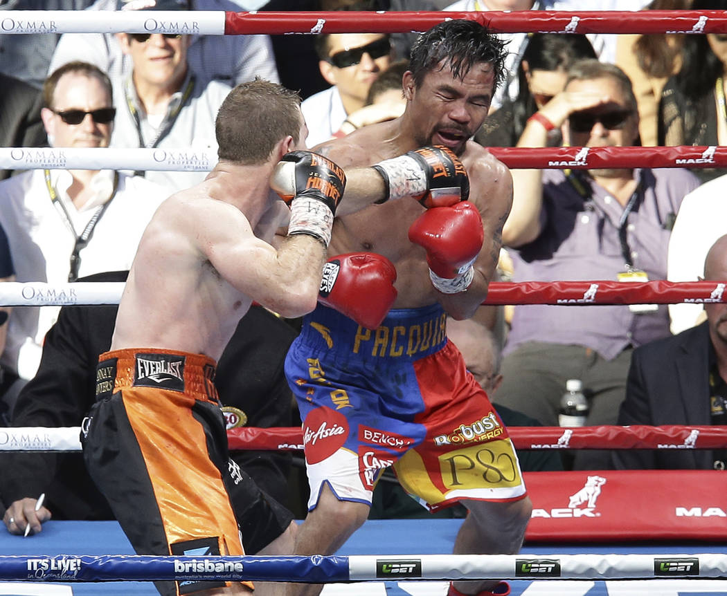 Manny Pacquiao, right, of the Philippines and Jeff Horn of Australia fight during their WBO World welterweight title bout in Brisbane, Australia, Sunday, July 2, 2017. Pacquiao lost his WBO welter ...