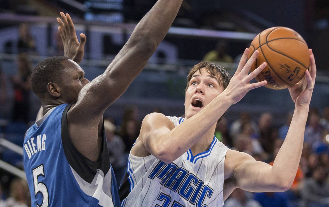 Orlando Magic center Stephen Zimmerman (33) is defended by Minnesota Timberwolves forward Gorgui Dieng (5) during the second half of an NBA basketball game in Orlando, Fla., Wednesday, Nov. 9, 201 ...