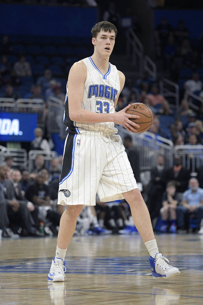 Orlando Magic center Stephen Zimmerman (33) controls the ball during the second half of an NBA basketball game against the Memphis Grizzlies in Orlando, Fla., Monday, Dec. 26, 2016. The Magic won  ...