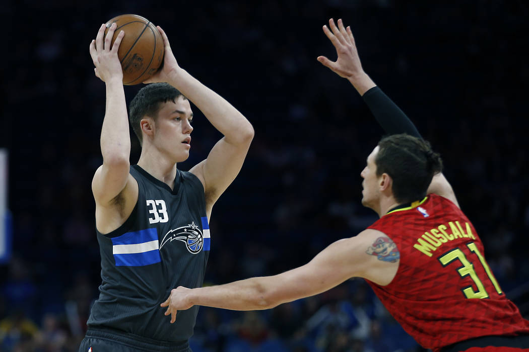 Atlanta Hawks forward Mike Muscala (31) guards Orlando Magic center Stephen Zimmerman (33) during the second half of an NBA basketball game in Orlando, Fla., on Saturday, Feb. 25, 2017.The Magic w ...