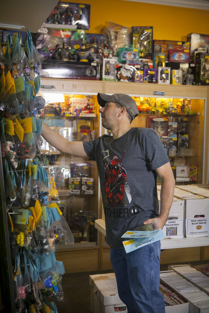 A customer at a Vintage Stock store in Kansas City, Missouri, looks through a selection of toys and figures. Vintage Stock is one of two companies owned by Las Vegas Valley-based holding company L ...