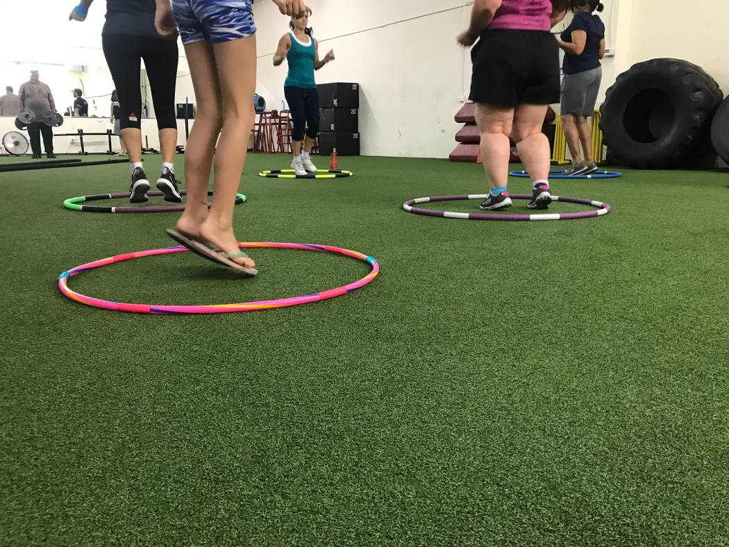 Students participate in class Get Hooping with Getti on June 1 at Bodysport Performance Training, 1922 Rock Springs Drive. (Kailyn Brown/View) @KailynHype
