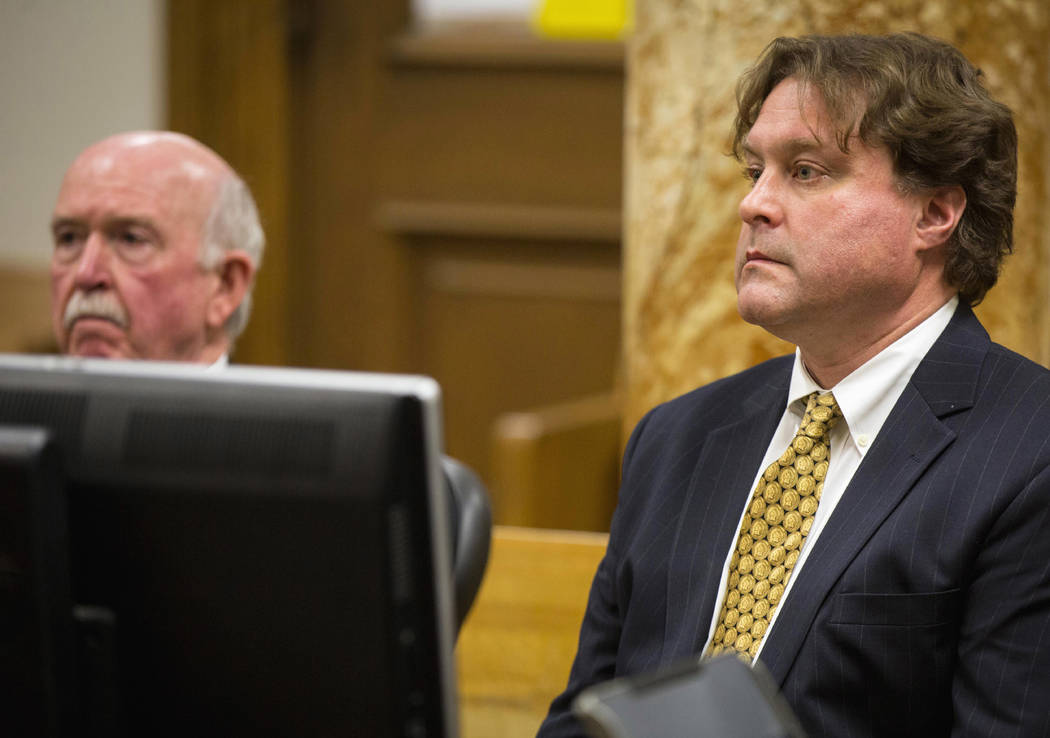 Texas businessman Robert Rhodes, right, faces a judge with his attorney Joseph Cahill on January 9 in Polk County District Court in Des Moines, Iowa. After Rhodes collected a Wisconsin Lottery jac ...