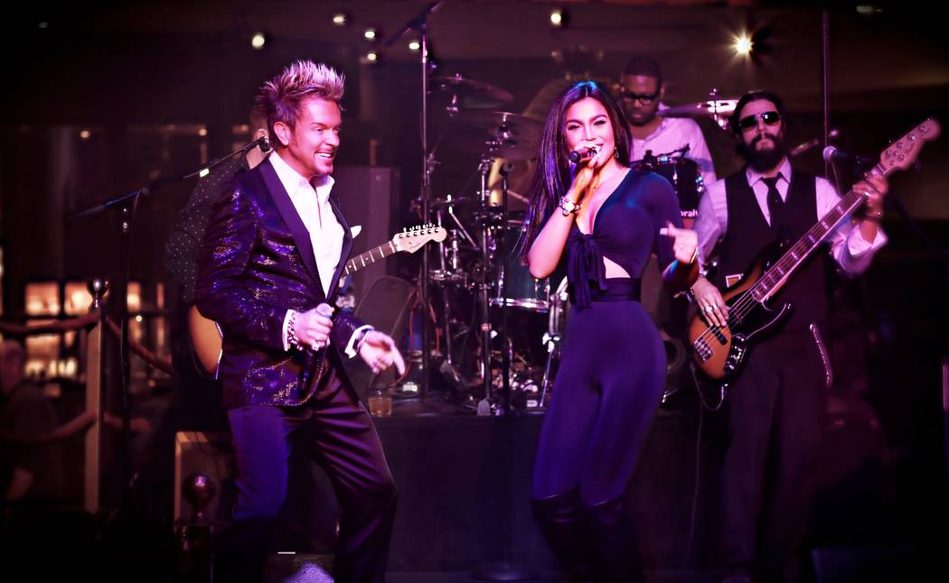 Chris Phillips and background singer, Jaime Lynch, of Zowie Bowie with band performing in Las Vegas. Courtesy of Chris Phillips