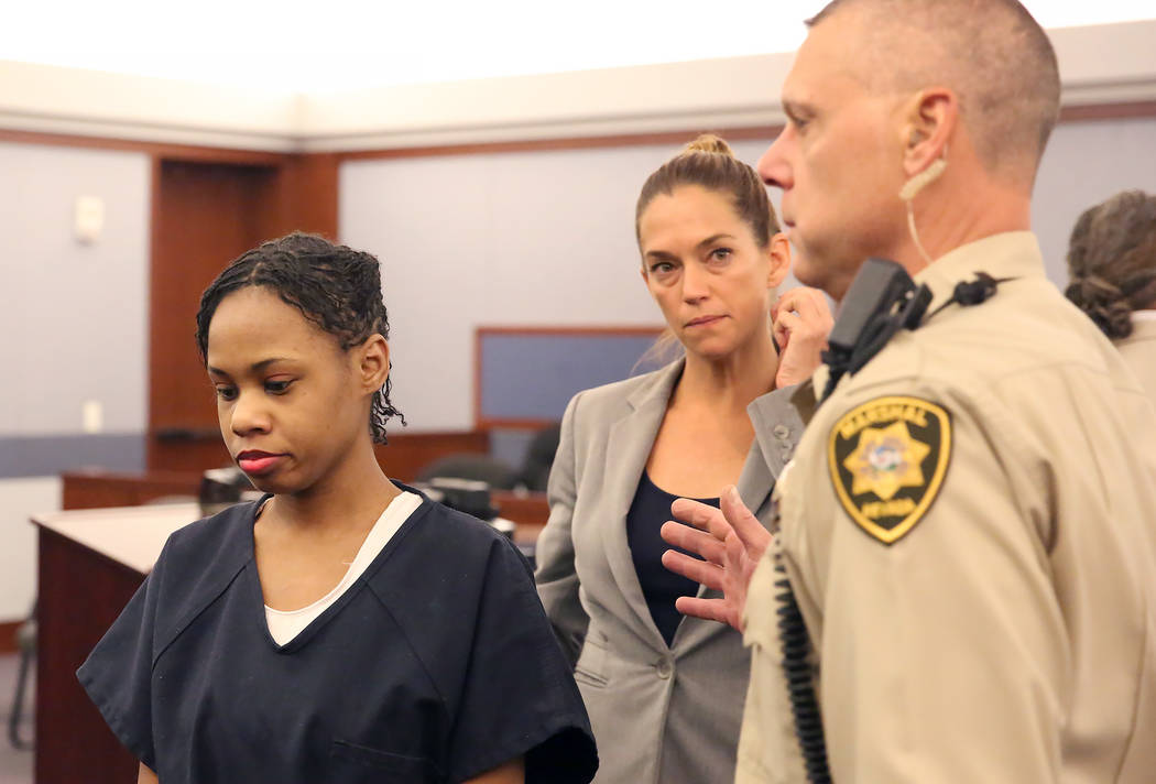 Danielle Slaughter, left, with her defense attorney Julia Murray, leaves the courtroom at the Regional Justice Center on Thursday, July 6, 2017, in Las Vegas. Slaughter was found guilty of fatally ...