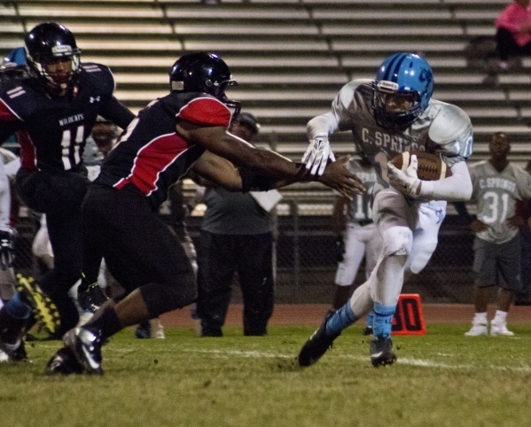 Canyon Springs' Diamante Burton (10) tries to elude tacklers during their prep football game at Las Vegas High School on Friday, Oct. 16, 2015. Daniel Clark/Las Vegas Review-Journal