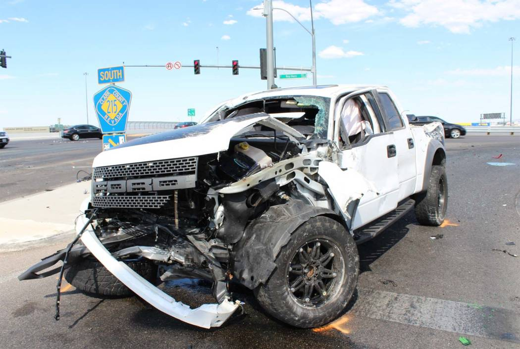 Nevada Highway Patrol says a man driving a Ford F-150 truck ran a red light at 215 Beltway and Sunset Road offramp in southwest Las Vegas and collided with a Toyota Camry, Wednesday, July 5, 2017. ...