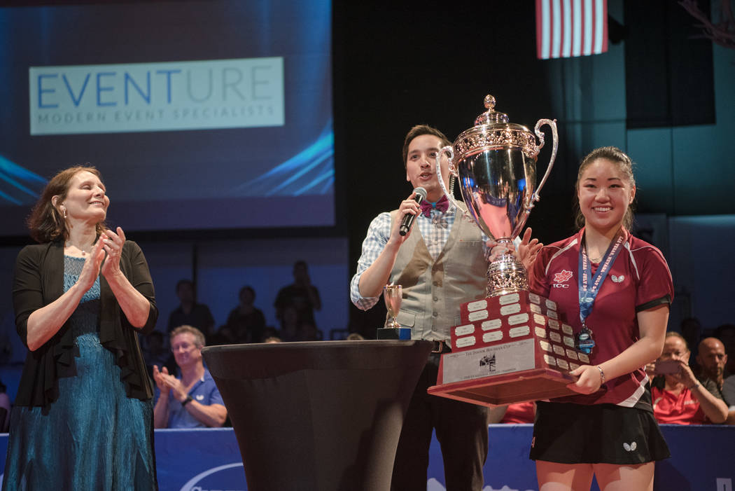 "Lily Zhang receiving her championship trophy after competing in the USA Table Tennis 2017 Supermicro National Championship ""Final Table Celebration""at Silverton hotel-casino on Frida ..."
