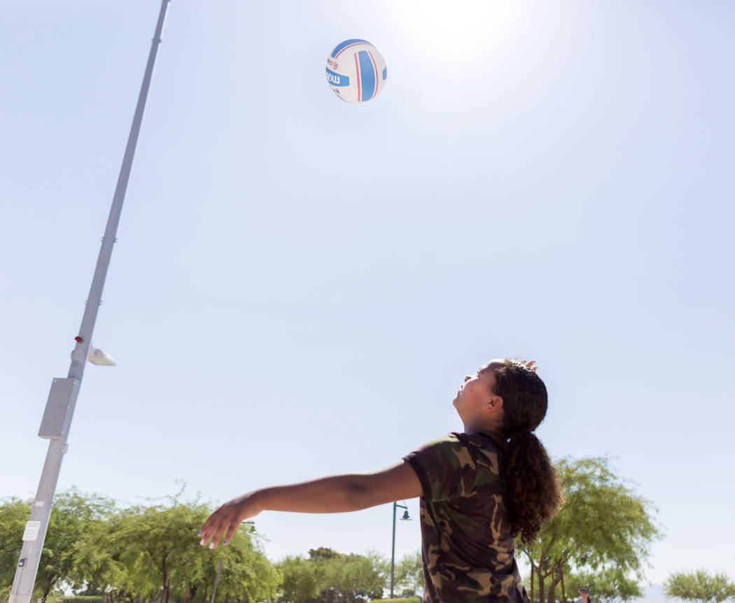 Ariana Johnson, 12, practices serving at Craig Ranch Regional Park in Las Vegas, Thursday, July 6, 2017. (Elizabeth Brumley/Las Vegas Review-Journal)