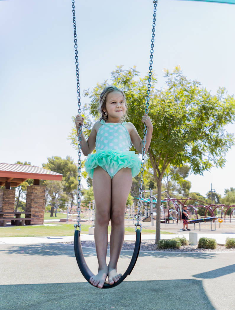 Macaylah Gillins, 6, swings at Craig Ranch Regional Park in Las Vegas, Thursday, July 6, 2017. (Elizabeth Brumley/Las Vegas Review-Journal)