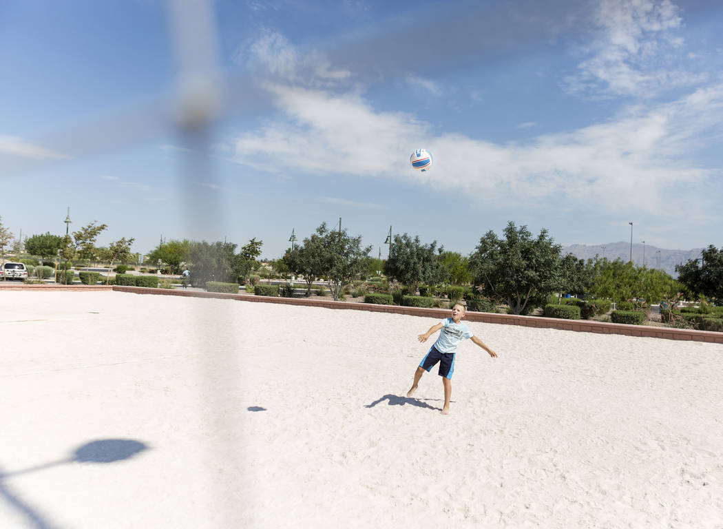 Cole Concoby, 10, serves at Craig Ranch Regional Park in Las Vegas, Thursday, July 6, 2017. (Elizabeth Brumley/Las Vegas Review-Journal)
