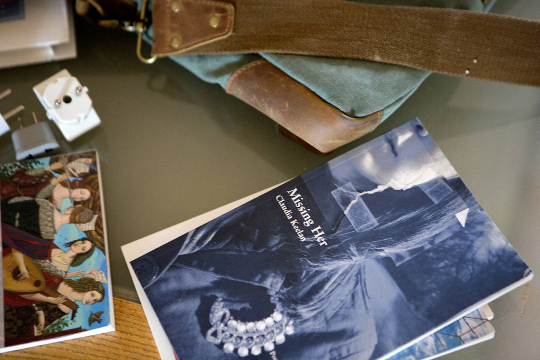 """One of UNLV professor and poet Claudia Keelan's books, """"Missing Her,"""" is pictured at her home in Las Vegas along with other things she is packed for Cuba on Thursday, July 6, 201 ..."""