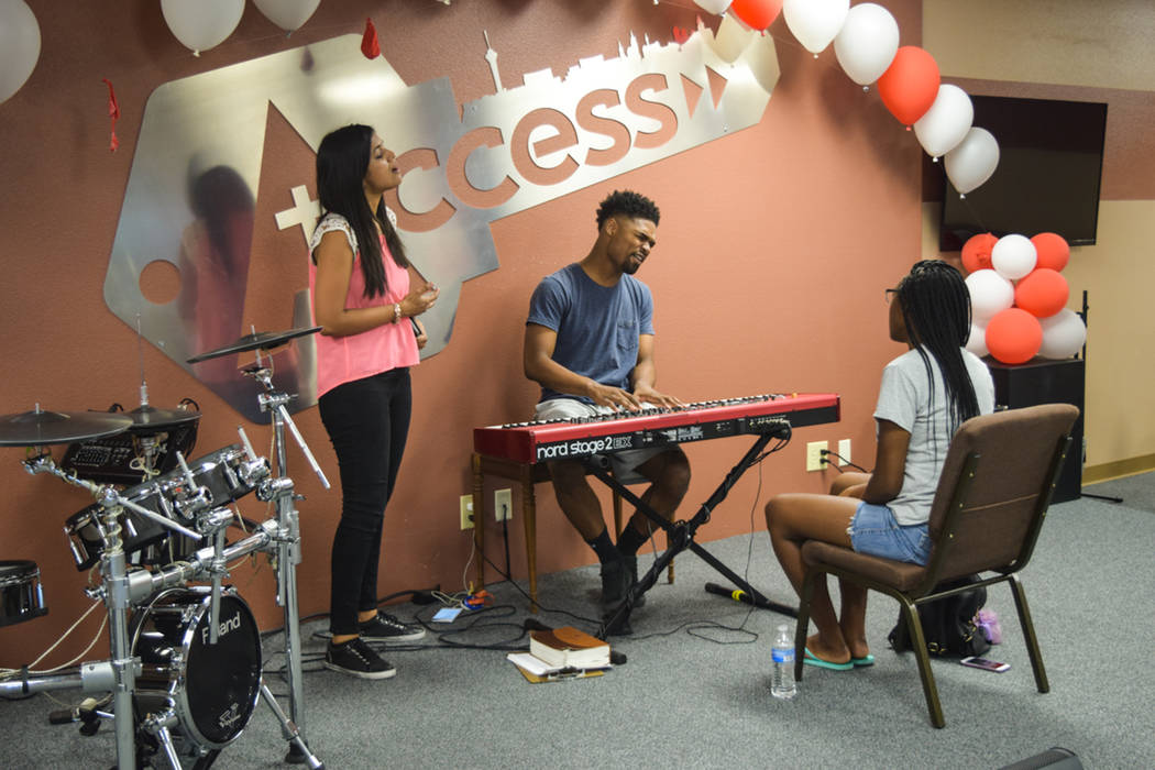 Remnant's director of missionaries, Sherin George, joined in a choir practice with youth member Jasmin Fitch and worship leader Vashawn Nash on July 5. (Alex Meyer/View) @alxmey