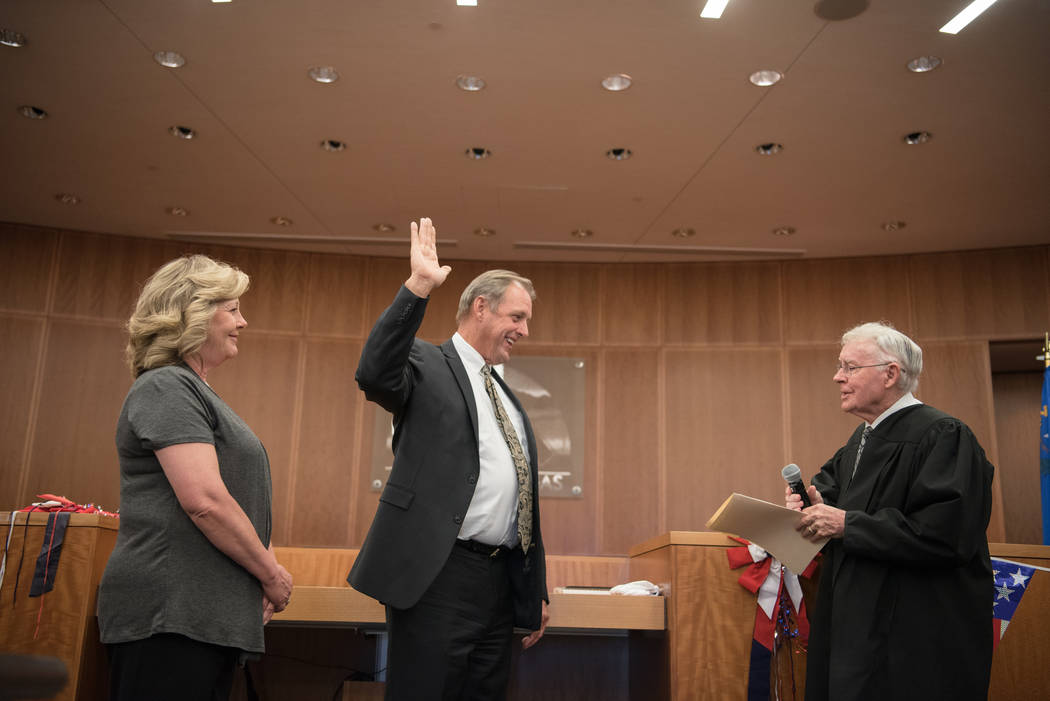 Mayor John Lee with his wife, Marilyn, and U.S. District Court Judge Lloyd D. George during his swearing in ceremony at North Las Vegas City Hall on Wednesday, July 5, 2017, in Las Vegas. Morgan L ...