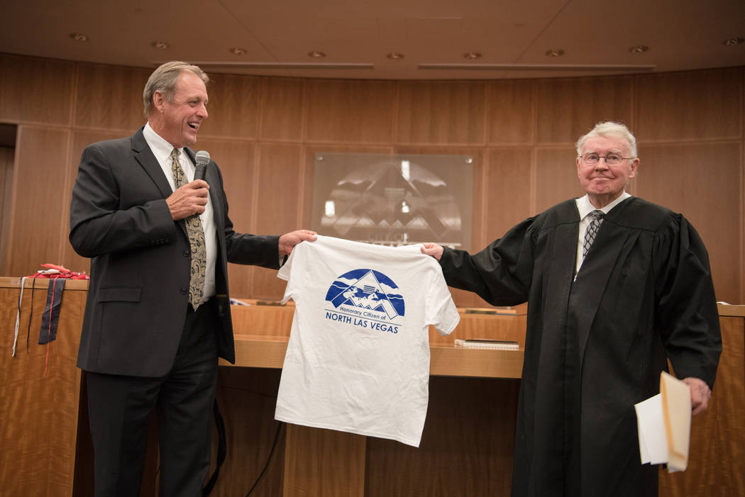 Mayor John Lee presenting a gift to U.S. District Court Judge Lloyd D. George after his swearing in ceremony at North Las Vegas City Hall on Wednesday, July 5, 2017, in Las Vegas. Morgan Lieberman ...