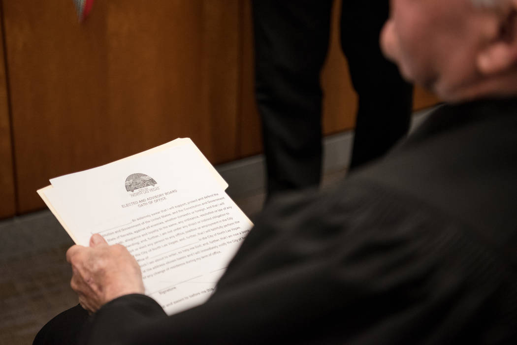 "U.S. District Court Judge Lloyd D. George holds the ""Oath of Office"" script after the ceremony at North Las Vegas City Hall on Wednesday, July 5, 2017, in Las Vegas. Morgan Liebe ..."