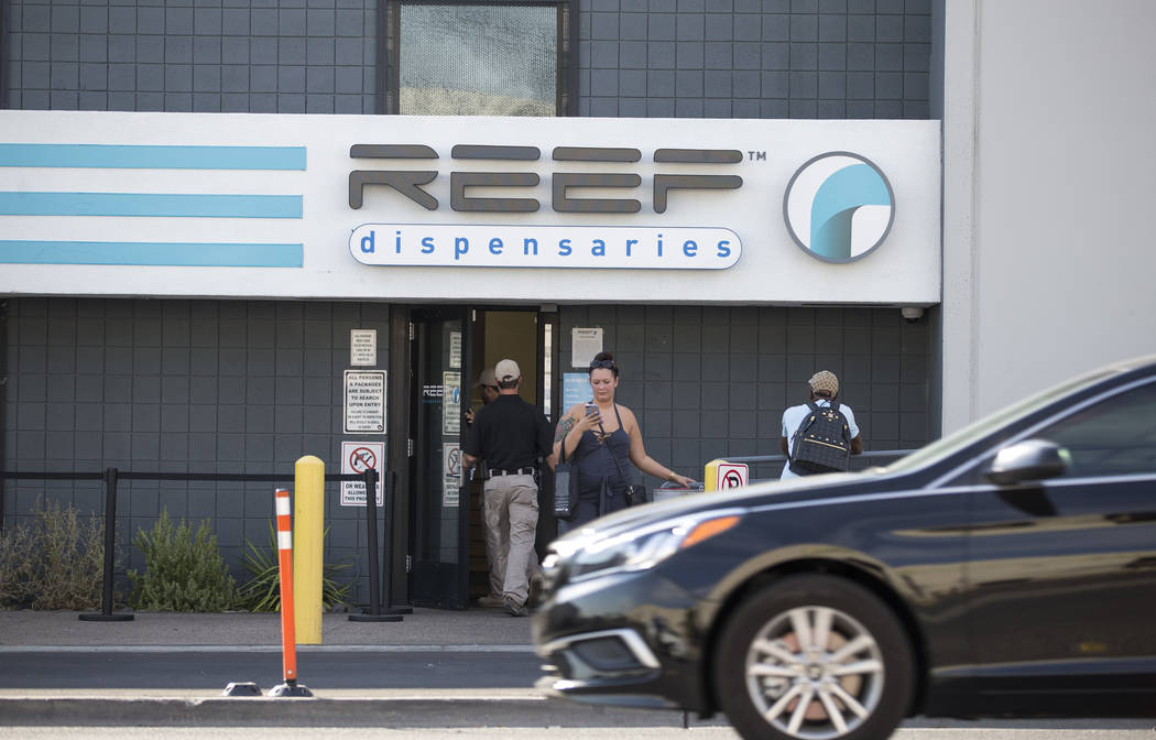 Customers stand outside Reef Dispensaries at 3400 Western Ave., near West Desert Inn Road and Sammy Davis Jr. Drive, in Las Vegas on Thursday, July 6, 2017. Firefighters responded to a small fire  ...