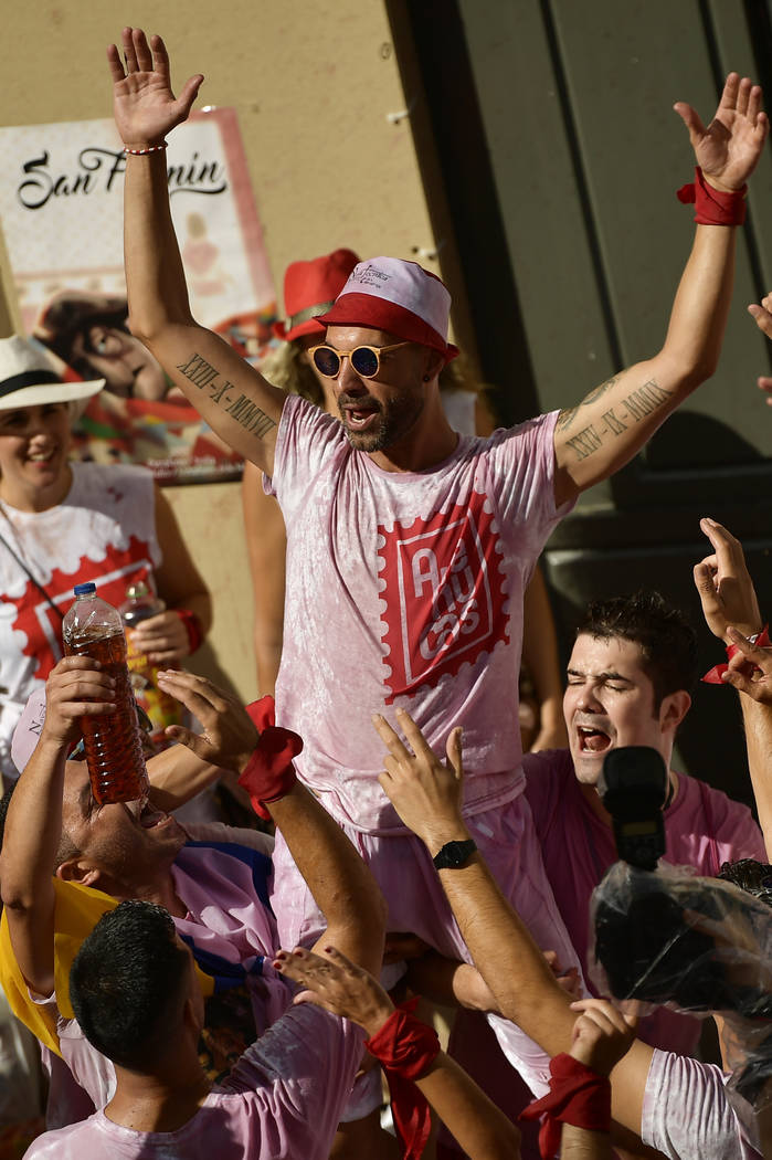 Revellers party during the launching of the 'Chupinazo' rocket, to celebrate the official opening of the 2017 San Fermin Fiestas in Pamplona, Spain, Thursday July 6, 2017. The first of eight days  ...