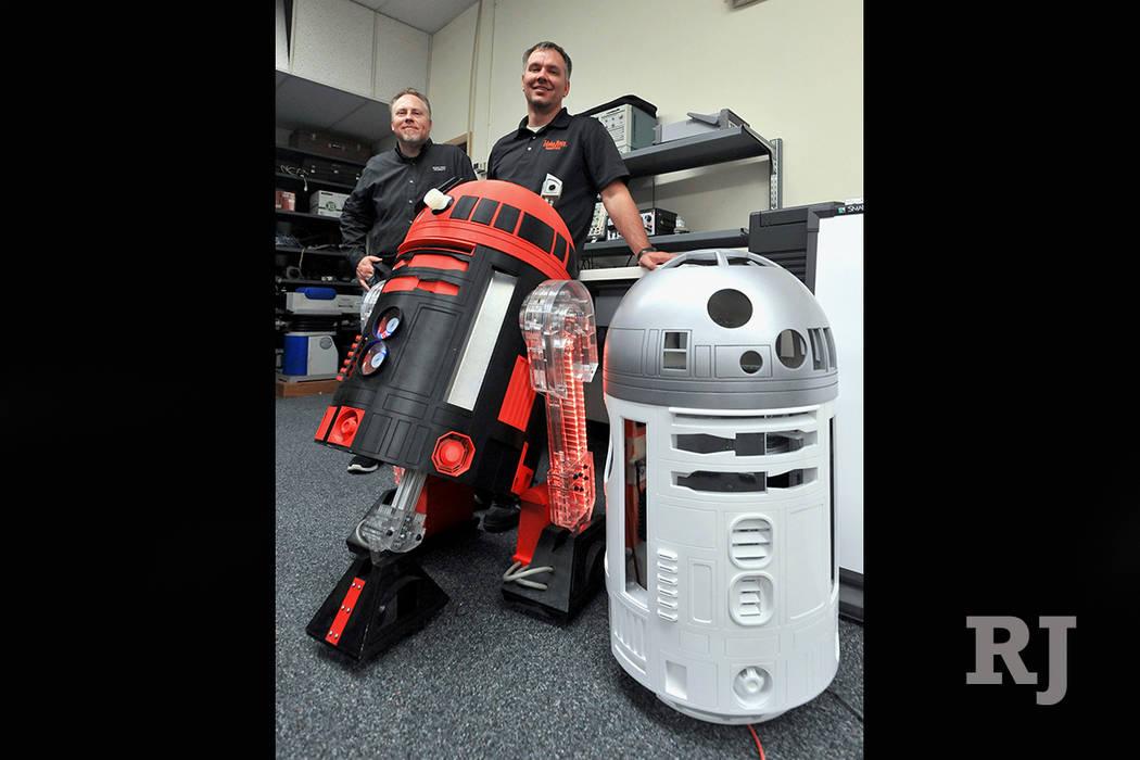 Idaho State University robotics program coordinator Shane Slack, left, and Geran Call, ISU associate professor of robotics, pose with R2-D2s that were 3-D printed on June 26, 2017. (Doug Lindley/T ...