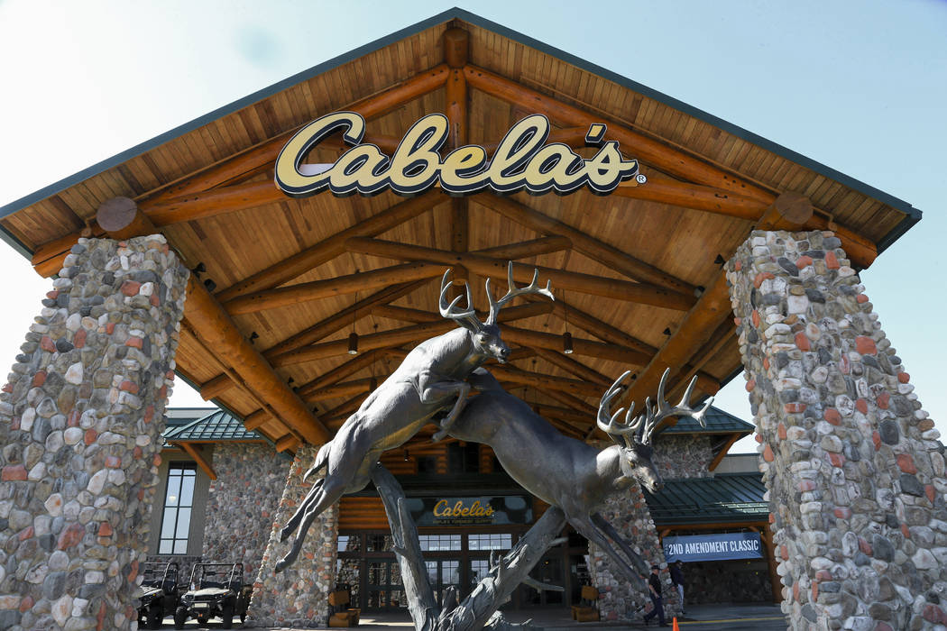 Statues of wildlife adorn the entrance to a Cabela's store in LaVista, Nebraska. U.S. antitrust regulators ended their investigation Wednesday, July 5, 2017, into Bass Pro Shops' $4 billion deal t ...