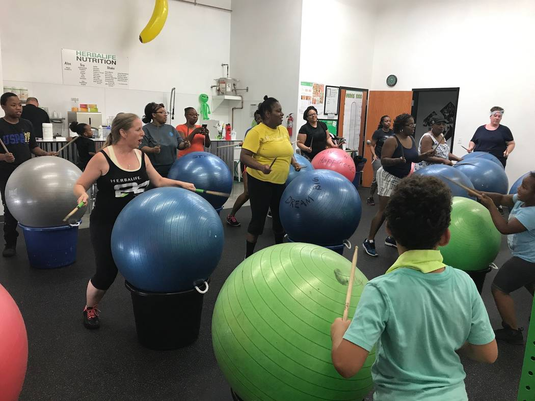 Paula Pecorella (middle left) leads a cardio drumming fitness class at Area 51 Fit in Southwest Las Vegas. (Madelyn Reese/View) @MadelynGReese
