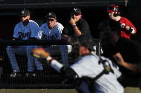 Head coach Tim Chambers, second from left, watches the action as UNLV takes on Arizona State during a game at Earl E. Wilson Stadium in Las Vegas on April 10.