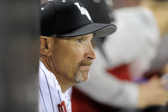 UNLV Rebels head coach Tim Chambers (34) watches from the dugout in the fifth inning of their season opening college baseball game at Earl E. Wilson Stadium in Las Vegas, Friday, Feb. 13, 2015. Ne ...