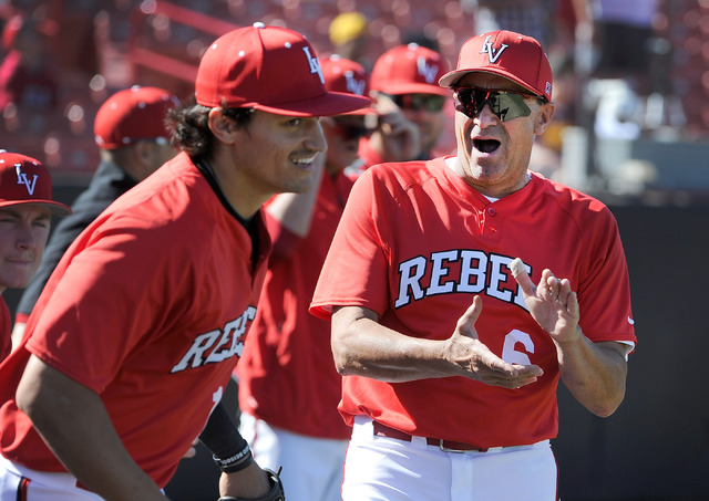 UNLV coach Tim Chambers, right, applauds his team as they take the field against Central Michigan during an NCAA baseball game at Earl E. Wilson Stadium at UNLV on Sunday, Feb. 16, 2014. UNLV won  ...