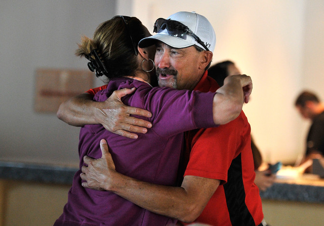 UNLV head coach Tim Chambers, right, is congratulated by UNLV athletic director Tina Kunzer-Murphy as their team celebrates their selection into the NCAA Division I Baseball tournament at UNLV on  ...