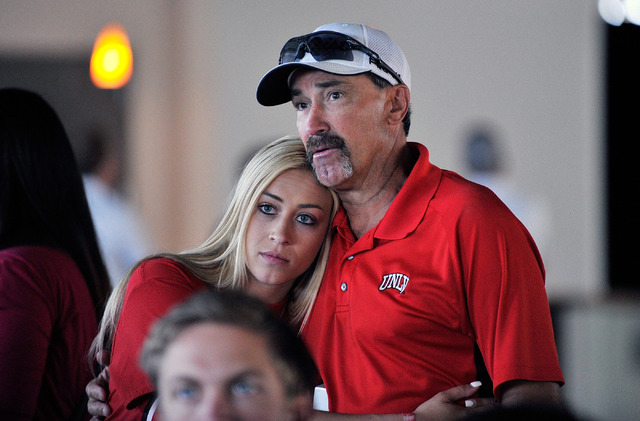 UNLV baseball head coach Tim Chambers, right, with his daughter, McKenzie Chambers, await the announcement of his teams selection into the NCAA Division I Baseball tournament at UNLV on Monday, Ma ...