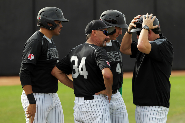 UNLV head coach Tim Chambers, center, talks with players and a coach during a pitching change during their 7-1 defeat of Grand Canyon University Tuesday, March 17, 2015 at Earl E. Wilson Stadium.  ...